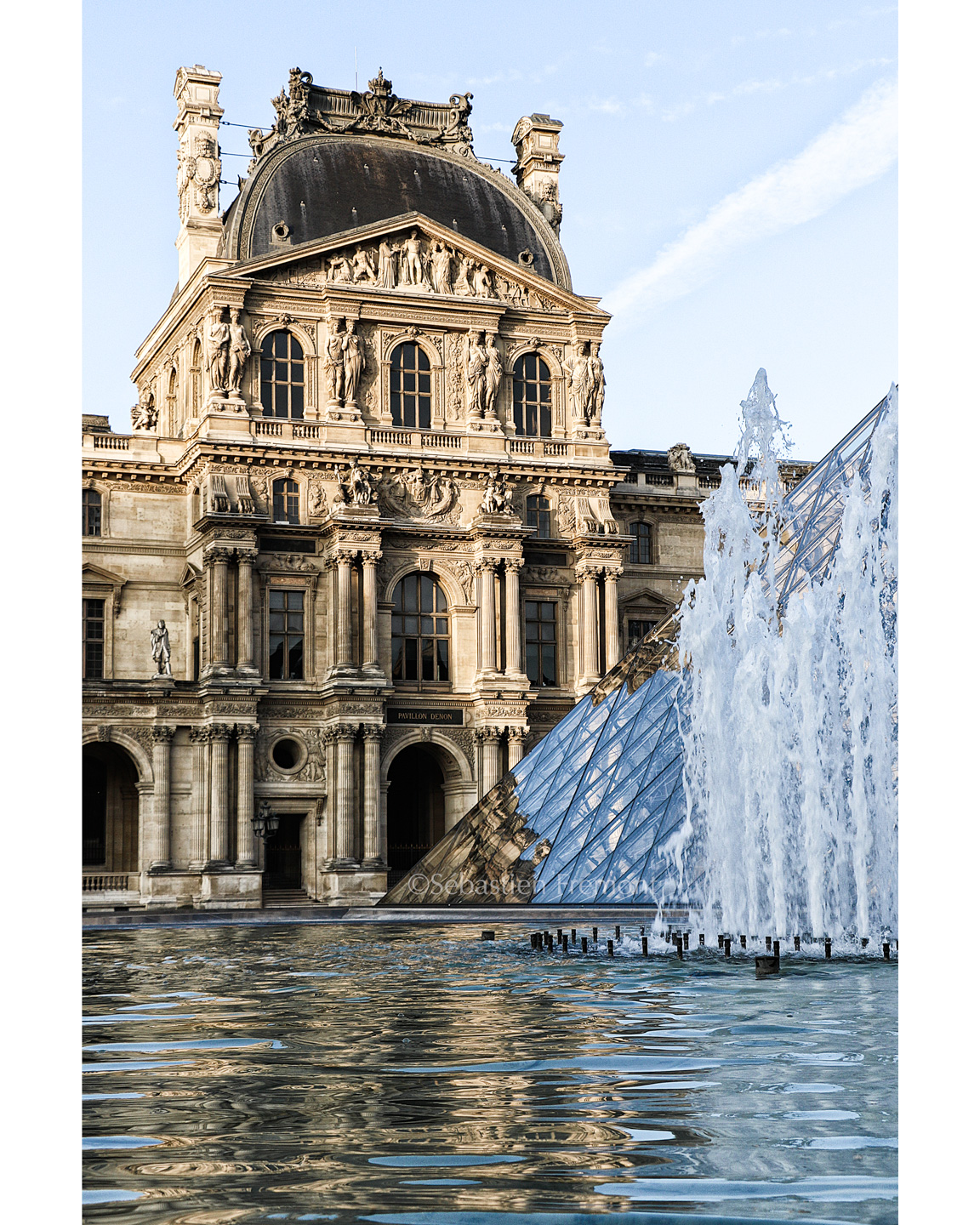 French Photographer Art Photography The glass pyramid and fountain at Louvre museum