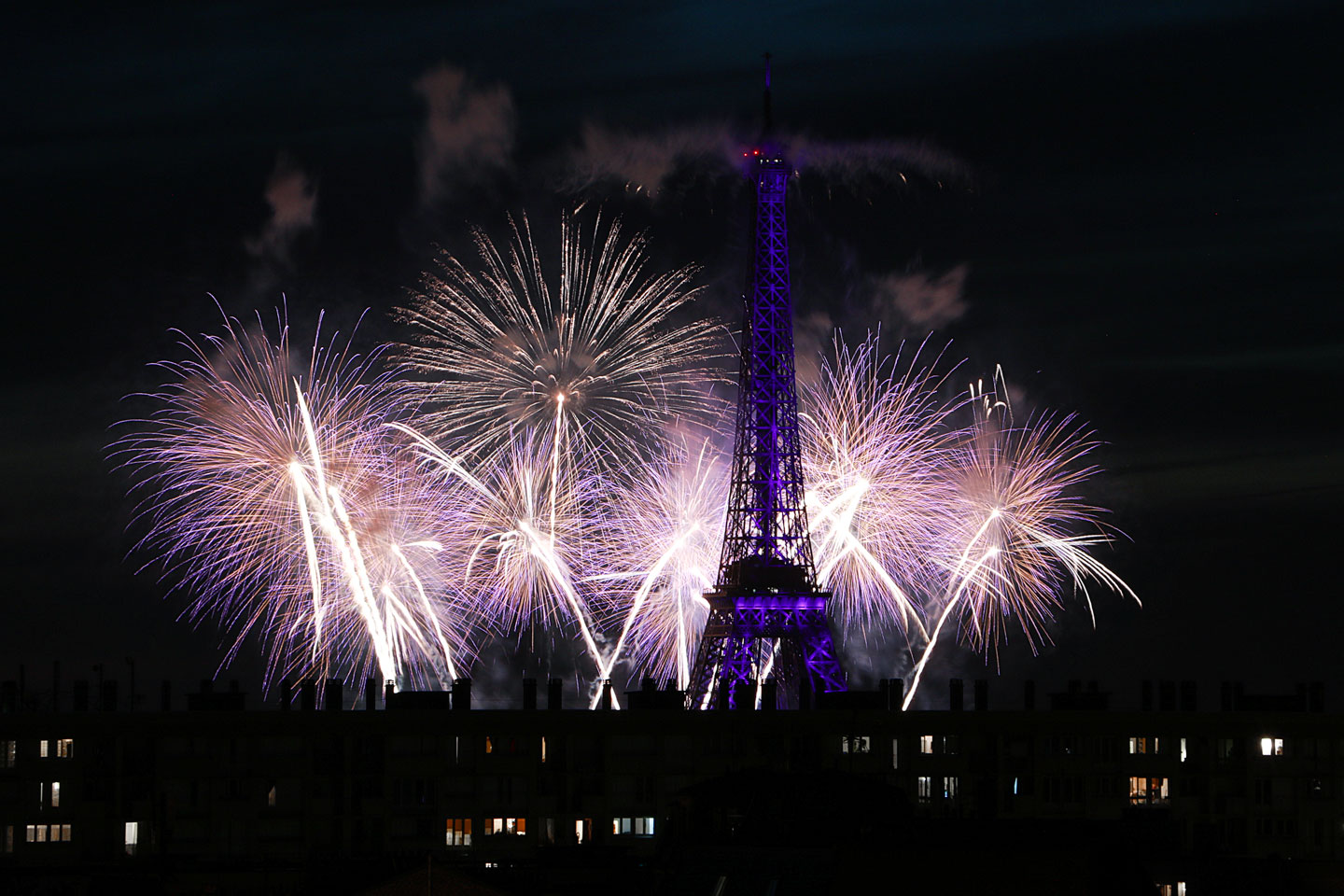 French Photographer Paris France Landscape Photography Eiffel Tower Lit Up Purple and fireworks for Bastille day