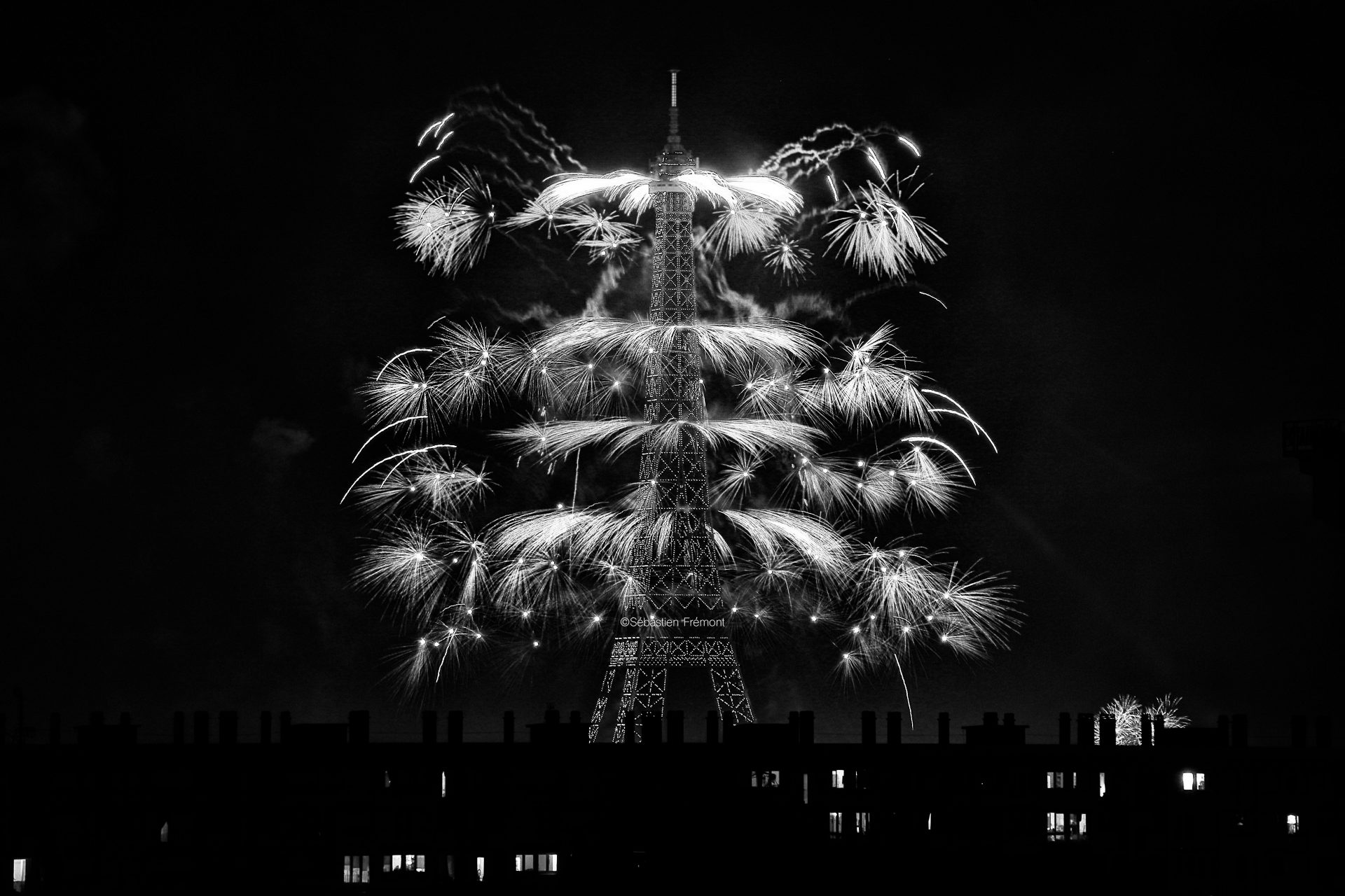 French Photographer Paris France Landscape Photography Eiffel Tower Lit Up and fireworks for Bastille day